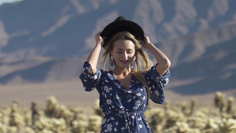 girl dresses a hat in the desert Footage