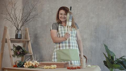 Happy woman creating edible bouquet arrangement Footage