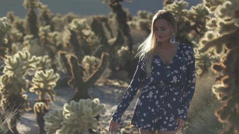 cute girl near desert cacti Live Action