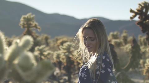 cheerful girl near desert cacti Live Action