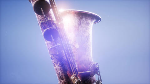 Golden Tenor Saxophone on blue background with light 영상물