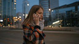 Young Woman is Talking on Phone and Walking in the Night Modern City Center 영상물