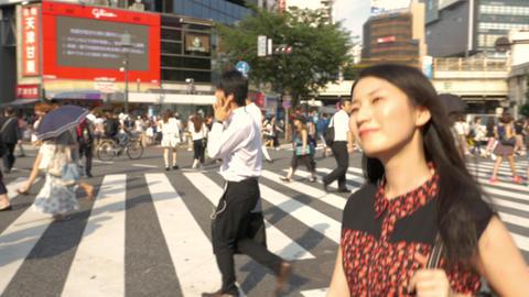Japanese Woman Walks Across Shibuya Crossing In Tokyo 영상물