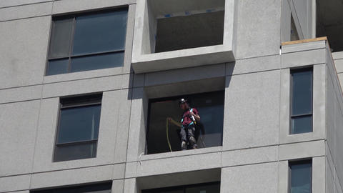 Construction worker on highrise building Footage