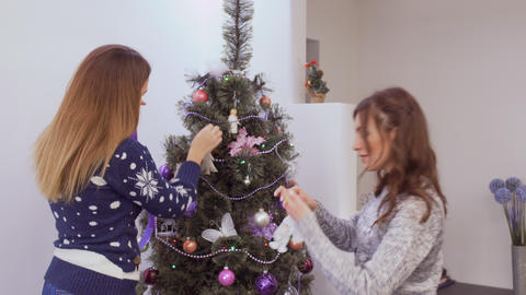 Girls decorate christmas tree Footage
