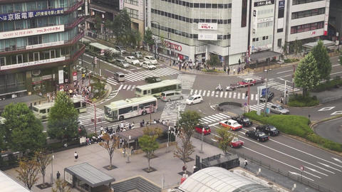 Pedestrian traffic of people crossing the intersection at Kyoto Station, Japan Footage