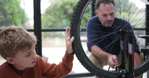 Father teaching Son how to care for his bicycle Footage