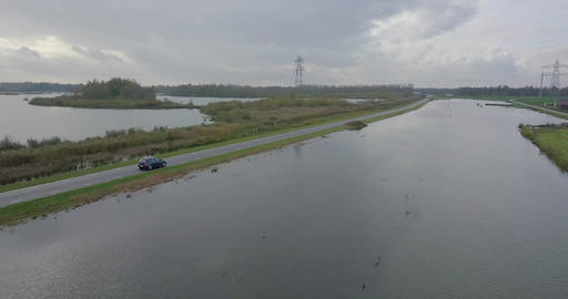 4k Cinematic Aerial shot of a Volkswagen Golf driving in the Dutch country side 영상물