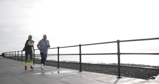 Senior couple jogging together Footage