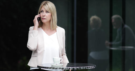 Female business executive using a smartphone in a cafe…, Live Action