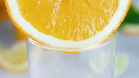 Closeup slow motion footage of fresh juice dripping from... Stock Video Footage