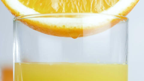 Slow motion video of glass being filled with fresh orange juice Footage
