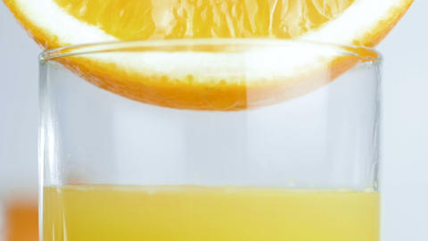 Slow motion video of glass being filled with fresh orange... Stock Video Footage