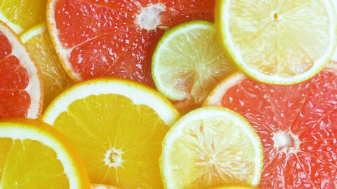 Macro slow motion video of camera moving over assortment of citrus fruits lying Footage