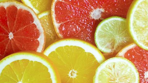 Closeup slow motion footage of falling orange, lemon and grapefruit slices Footage