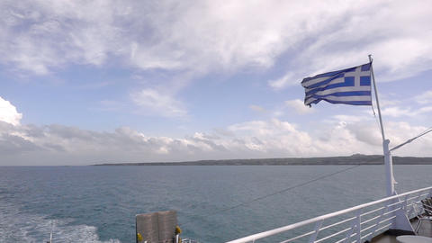 Ferry boat in Greece view on sea and waving national flag Footage