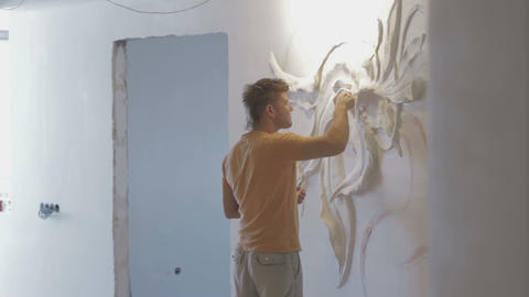 The process of molding stucco and bas-relief on the wall Footage