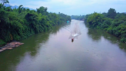 Boat sailing on Kwai Noi river ビデオ
