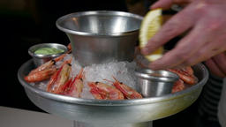 The cook prepares dish of boiled shrimp on ice 영상물