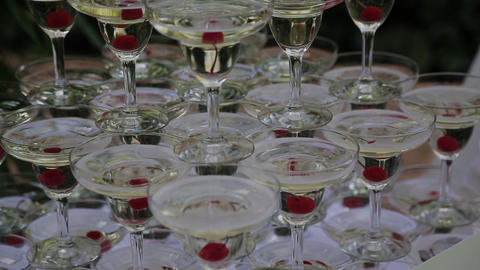 The guests' hands take glasses with bubbling wine at the party. Glasses are Footage