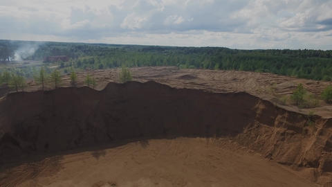 Flight over sand quarry open pit GIF