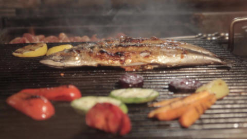 grilled fish on the grill closeup Live Action