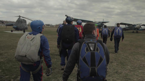 Group of athletes parachutists go to the plane before take-off Footage