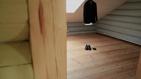 A man's jacket hangs on a hanger in the room Footage