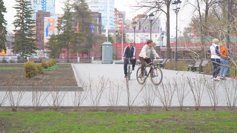 Two guys riding bicycles in the Park Footage