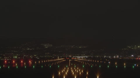 Airplane to take off from the airport at night - back view Live Action