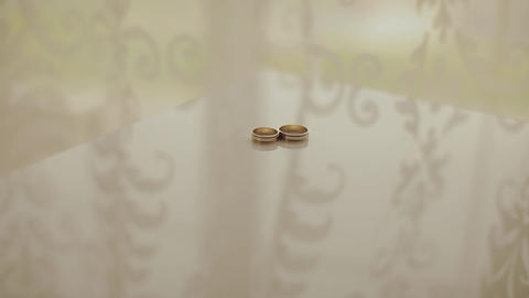 Wedding rings on a cushion for rings Footage