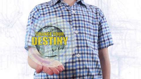 Young man shows a hologram of the planet Earth and text Change your destiny Live Action