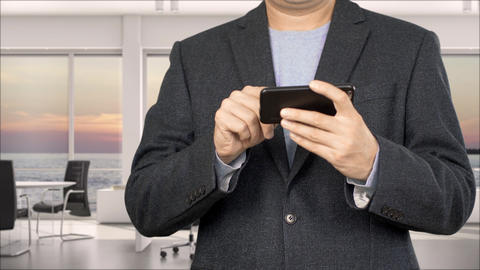 Businessperson in formal wear browsing on smartphone, cropped view Live Action