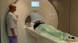 Doctor makes brain tomography for a woman on MRI scan Footage