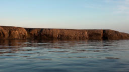 Coast and sunset and water surface of Arctic Ocean on New Earth Vaigach Island Footage