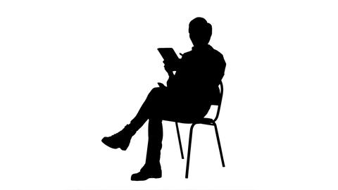 Silhouette Portrait of female doctor with tablet computer reading medical report Footage