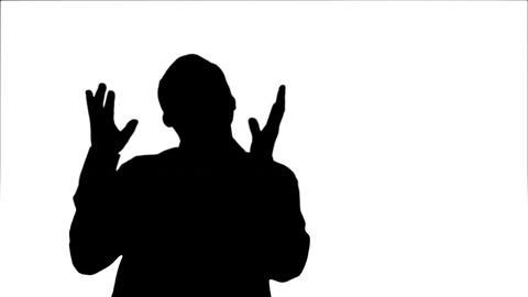 Silhouette Bearded young man happily dancing and singing Footage