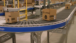 [alt video] Products on conveyor belt, followed by camera around curves