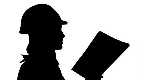 Silhouette Female construction engineer reading plans and talk to workers Footage
