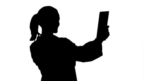 Silhouette Happy young doctor naving video conference on tablet with patient Live Action