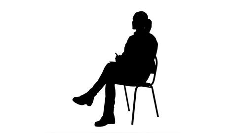 Silhouette Female doctor talking to a patien and writes in a notebook Footage