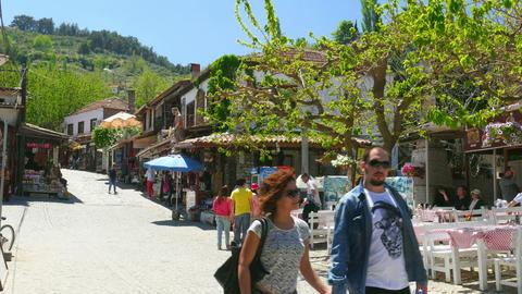 SELCUK, SIRINCE, TURKEY - MAY 2015: tourist people travel village Live Action