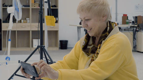 Mature woman make photo on smartphone in photo studio Footage