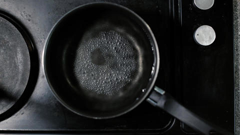 Boiling water, bubbles, kitchen, top view, pot, electric stove, HD Live Action