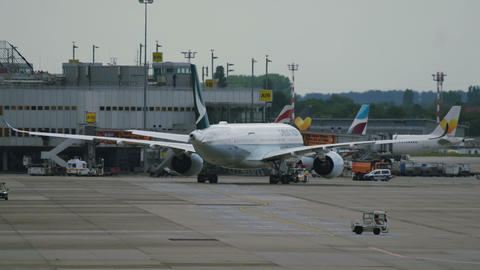 Cathay Pacific Boeing towing before departure Footage