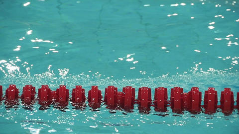 red swimming lane marker slow motion Live Action