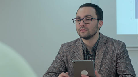Male teacher in class room giving the subject using tablet Footage