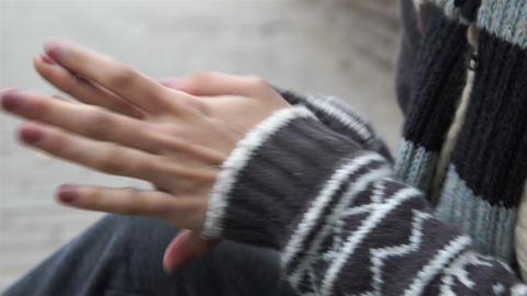 Homeless Teenage Rubbing Hands Footage