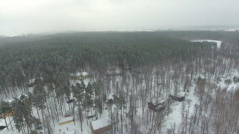 Aerial view of spa hotel in snowy forest in winter time Footage