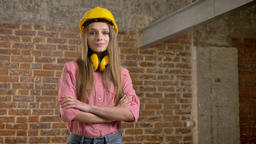 Young confident girl builder is crossing arms, raising eyebrow, nodding her head Footage